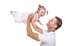 Portrait of father holding his adorable child on white background. A portrait of father holding his adorable child on white background Stock Photos