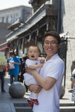 Portrait of father holding his baby son, outdoors Beijing Stock Image