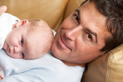 Portrait Of Father With Newborn Baby. At Home Stock Image