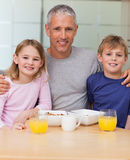 Portrait of a father posing with his children in the morning Royalty Free Stock Image