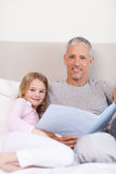 Portrait of a father reading a story to his daughter Royalty Free Stock Photography