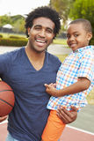 Portrait Of Father And Son On Basketball Court Stock Images