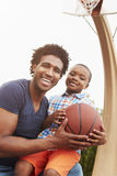 Portrait Of Father And Son On Basketball Court Royalty Free Stock Photos