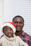Portrait of father and son at Christmas Royalty Free Stock Images