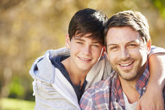 Portrait Of Father And Son In Countryside Stock Photos