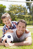 Portrait Of Father And Son With Football stock photo