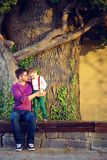 Portrait of father and son in front of old tree Stock Photo