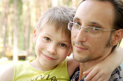 Portrait of father and son. Happy smiling father and son together outdoor stock images