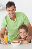 Portrait of father and son having breakfast Royalty Free Stock Photos