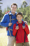 Portrait Of Father And Son On Hike In Beautiful Countryside Stock Images