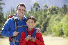 Portrait Of Father And Son On Hike In Beautiful Countryside Royalty Free Stock Photos