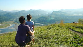 Portrait of Father with son looking to landscape. Portrait of Father with his son looking to the mountains stock video