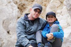 Portrait of father and son outdoors stock photography