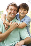 Portrait Of Father And Son In Park Stock Photo