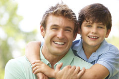 Portrait Of Father And Son In Park Stock Image