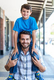 Portrait of a father and son piggybacking Stock Photo