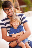 Portrait Of Father And Son Playing Outside Together Royalty Free Stock Photography