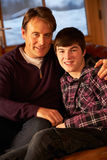 Portrait Of Father And Son Relaxing Royalty Free Stock Photos