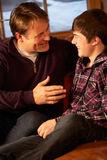 Portrait Of Father And Son Relaxing Royalty Free Stock Images