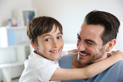 Daddy and son complicity. Portrait of father and son relaxing at home stock photo