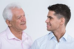 Portrait of a father and son. Shot of a father and son looking at each other's eyes stock photography