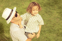 Portrait a father and son sitting on the grass Royalty Free Stock Photography
