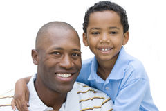 Portrait of father and son smiling, close-up, cut out Stock Image