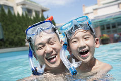 Portrait of father and son with snorkeling equipment in the pool Royalty Free Stock Photography