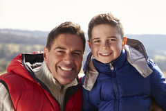 Portrait of father and son wearing coats in the countryside Royalty Free Stock Images