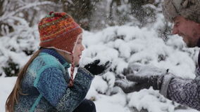 Portrait of a father and sons playing snowballs. Man and child in the park in winter. stock video footage