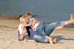Portrait of a father and two sons Stock Photo