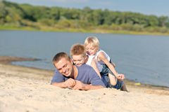 Portrait of a father and two sons Stock Photography