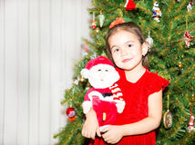 Portrait of fazakh, asian child girl around a Christmas tree decorated. Kid on holiday new year Royalty Free Stock Photos