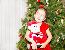 Portrait of fazakh, asian child girl around a Christmas tree decorated. Kid on holiday new year Royalty Free Stock Photography