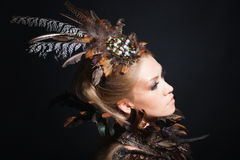 Portrait with feather Stock Image
