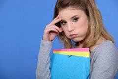 Portrait of a fed-up student. Holding her school books Royalty Free Stock Image