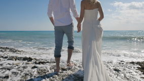 Portrait of feet newlyweds on the beach stock video