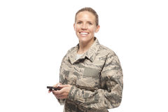 Portrait of female airman with mobile phone Royalty Free Stock Photography