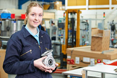 Portrait Of Female Apprentice Holding Component Stock Photography