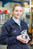 Portrait Of Female Apprentice Holding Component Stock Photo