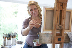 Portrait Of Female Artist Painting In Studio Stock Photos