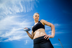 Portrait of female athlete holding a discus royalty free stock photography