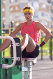 Portrait of Female Athlete in Professional Training Outfit Having Outdoor Workout Exercises Royalty Free Stock Image
