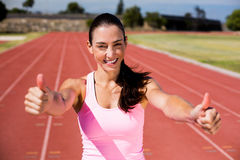Portrait of female athlete showing her thumbs up Stock Photos