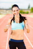 Portrait of female athlete showing her thumbs up Stock Photography