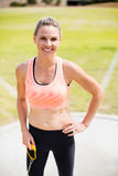 Portrait of female athlete standing with hands on hips stock image