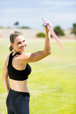 Portrait of female athlete about to throw a javelin. In the stadium stock photos