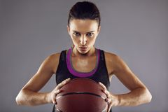 Portrait of female basketball player in studio Stock Photos