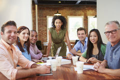 Portrait Of Female Boss With Team In Meeting Stock Photography