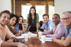 Portrait Of Female Boss With Team In Meeting Royalty Free Stock Image